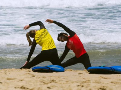 warm up before surfing lesson