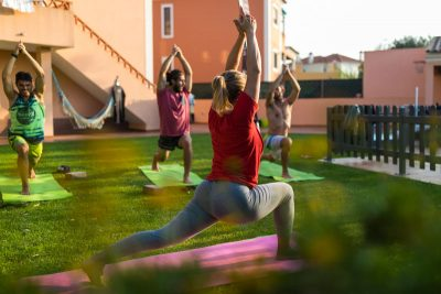 surf camp portugal yoga session garden